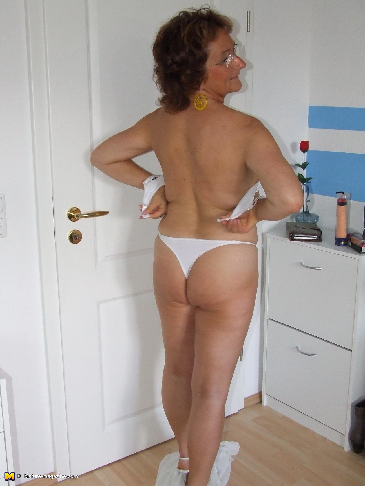 A hairy mature wife first time nude on a nudist beach 3
