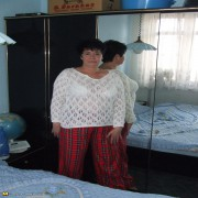 This chubby mama gets horny on her bed