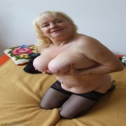 big titted mama playing on her bed