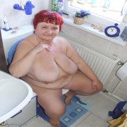 Red housewife taking off all her clothes