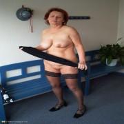 Horny mama getting naked