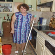 This housewife loves to get naked in the kitchen