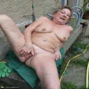 Naughty housewife getting horny in the garden