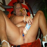 This naughty housewife loves to play ith her food